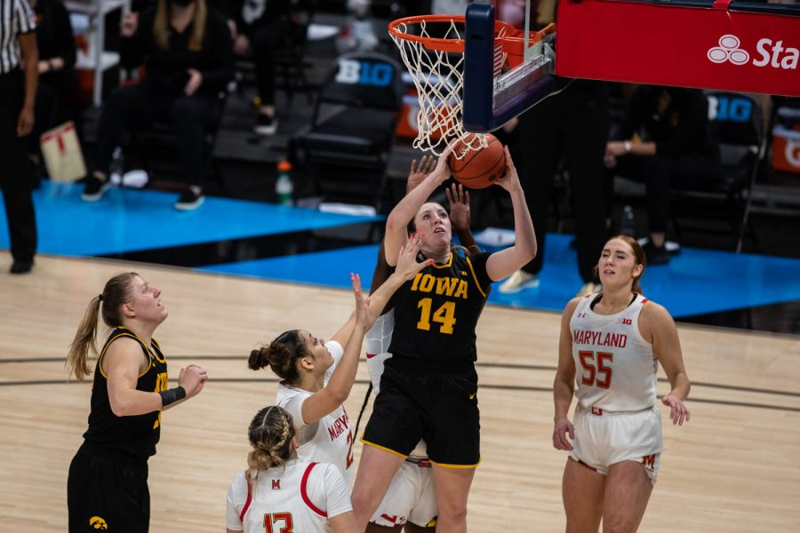 Iowa's McKenna Warnock (14) takes a shot during the championship game of the Big Ten women's basketball tournament. Iowa, ranked No. 6, took on No. 1 seeded Maryland in Indianapolis at the Bankers Life Fieldhouse Saturday afternoon. Maryland beat Iowa, 104-84, securing their spot as the 2021 Big Ten Champions.