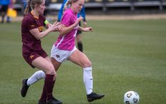 Iowa Midfielder Hailey Rydberg keeps the ball away from Minnesota's defense during a soccer game between Iowa and Minnesota on March 14, 2021 at the Iowa Soccer Complex. The Gophers defeated the Hawkeyes 1-0.