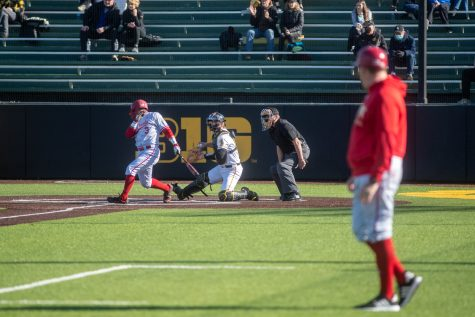 Iowa Catcher Austin Martin winds up to throw the ball around the field following a strike out of Nebraska Right Fielder Logan Foster during a baseball game between Iowa and Nebraska at Duane Banks Field on March 19, 2021. The Hawkeyes defeated the Cornhuskers 3-0.