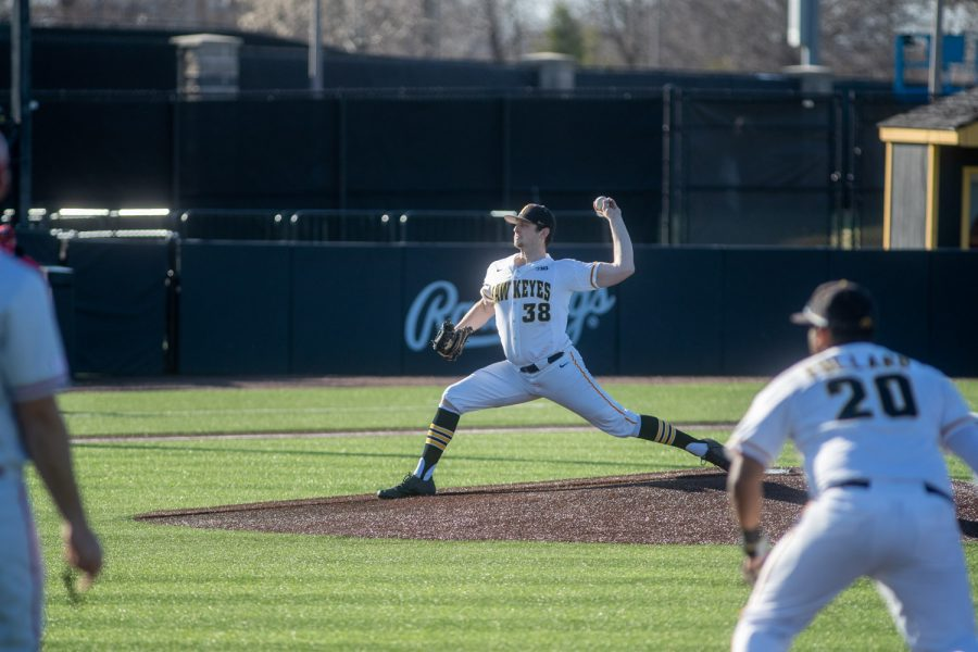 Iowa Pitcher Trenton Wallace pitches out of trouble during a baseball game between Iowa and Nebraska at Duane Banks Field on March 19, 2021. The Hawkeyes defeated the Cornhuskers 3-0.