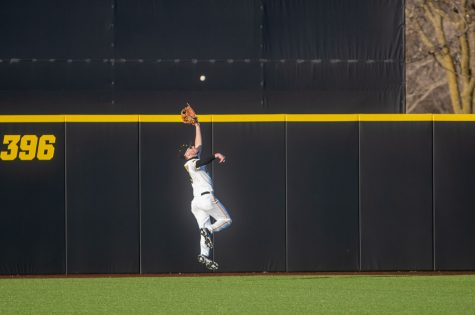 Iowa Center Fielder Ben Norman makes an over-the-shoulder catch to make the last out during a baseball game between Iowa and Nebraska at Duane Banks Field on March 19, 2021. The Hawkeyes defeated the Cornhuskers 3-0.