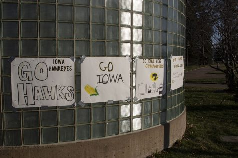 Signs for Iowa men's gymnastics hang outside the west entrance of Carver-Hawkeye Arena during the Iowa v. Nebraska men's gymnastics meet in Carver-Hawkeye Arena on Saturday, March 20, 2021. Iowa defeated Nebraska with a score of 406.700 - 406.650. This was the Hawkeye's last home meet of their final season.