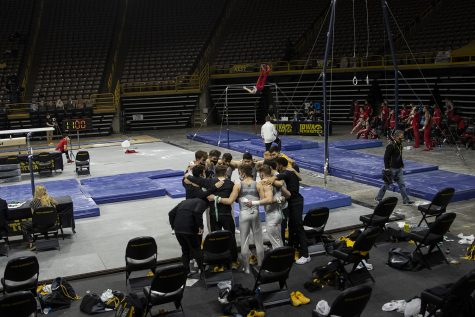 The Hawkeyes huddle between events during the Iowa v. Nebraska men's gymnastics meet in Carver-Hawkeye Arena on Saturday, March 20, 2021. Iowa defeated Nebraska with a score of 406.700 - 406.650. This was the Hawkeye's last home meet of their final season.