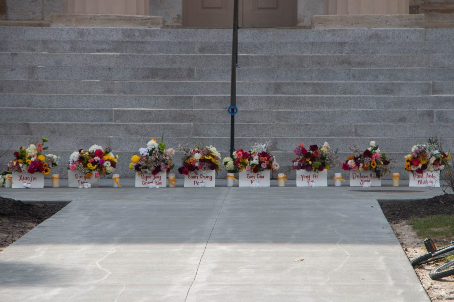 Eight buckets of flowers, each with their respective names, are seen during a vigil on Sunday, March 21 to honor the eight victims of the Atlanta shootings and advocate for Asian-American rights and equality.