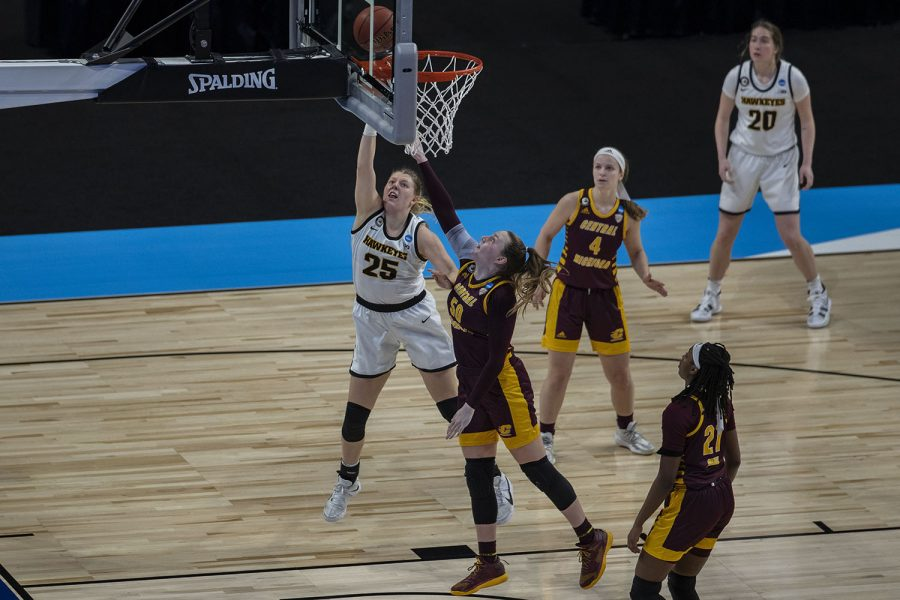Iowa forward Monika Czinano shoots a basket during the first round of the NCAA women's basketball championship against Central Michigan on Sunday, March 21, 2021 at the Alamodome in San Antonio, TX. The Hawkeyes defeated the Chippewas, 87-72. No. 5 Iowa will go on to play No. 4 Kentucky on Tuesday during the second round.