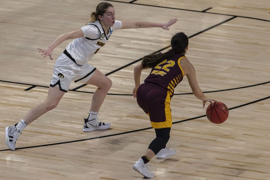 Iowa guard Kate Martin blocks Central Michigan guard Kalle Martinez during the first round of the NCAA women's basketball championship between Iowa and Central Michigan on Sunday, March 21, 2021 at the Alamodome in San Antonio, TX. The Hawkeyes are leading the Chippewas, 48-37 at halftime.
