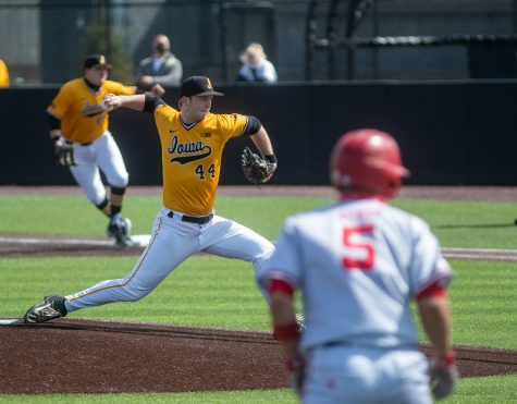 Iowa Pitcher Duncan Davitt throws a pitch during a baseball game between Iowa and Nebraska at Duane Banks Field on Sunday, March 21, 2021. Davitt went an inning and two-thirds, giving up five earned runs.The Cornhuskers defeated the Hawkeyes 13-8.