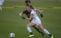 Iowa midfielder, Olivia Hellweg, and Penn State forward, Ellie Wheeler, fight for the ball during the Iowa women's soccer match v. Penn State at the Iowa Soccer Complex on Thursday, March 25, 2021. The Nittany Lions defeated the Hawkeyes 1-0.