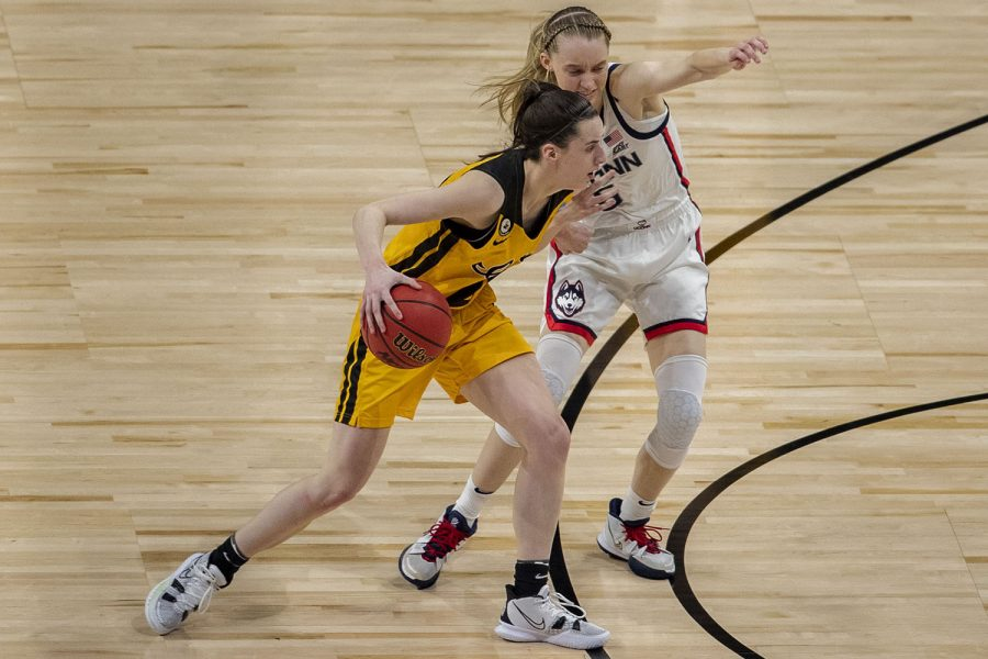 Iowa guard Caitlin Clark blocks UConn guard Paige Bueckers during the Sweet Sixteen NCAA women
