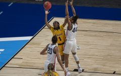 Iowa guard Tomi Taiwo attempts to shoot a basket during the Sweet Sixteen NCAA women's basketball championship against UConn on Saturday, March 27, 2021 at the Alamodome in San Antonio, Texas. The Hawkeyes were defeated by the Huskies, 92-72. While No. 5 Iowa played their last game today, No. 1 UConn will advance to the Elite Eight on Monday.