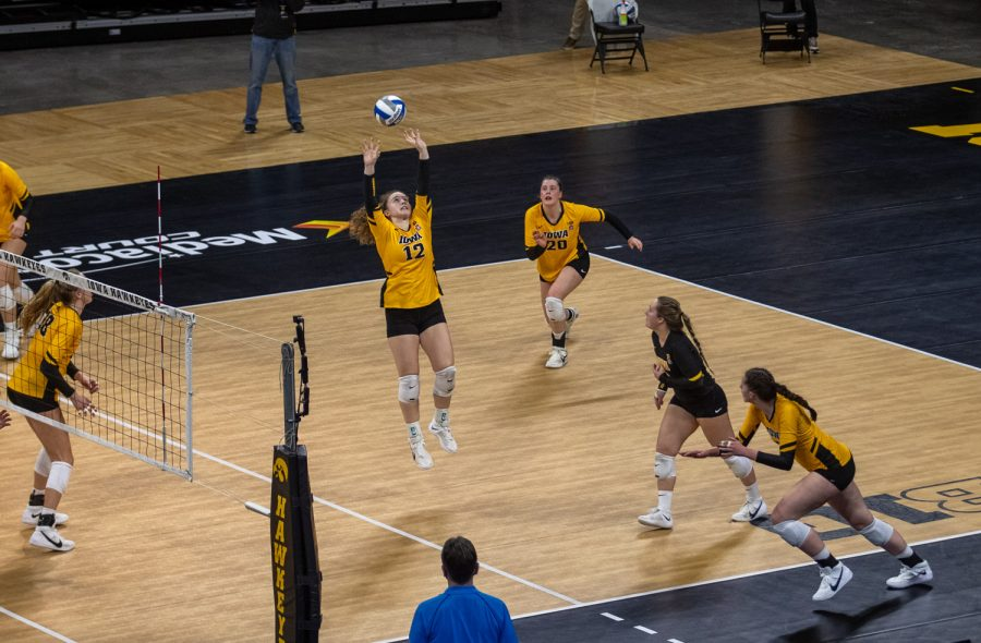 Iowa Setter Bailey Ortega sets a ball during a volleyball match between Iowa and Michigan State at Carver-Hawkeye Arena on Saturday, March 27, 2021. The Hawkeyes defeated the Spartans 3-0.