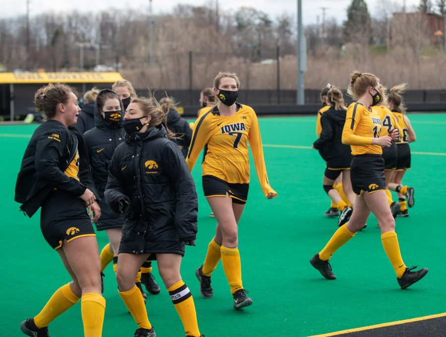 Iowa players celebrate and stretch during a field hockey game between Iowa and Michigan State at Grant Field on Friday, March 28, 2021. The Hawkeyes defeated the Spartans 2-0.