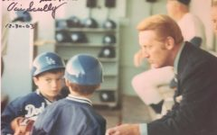 "Rod Lehnertz, age six, and his brother meet Los Angeles Dodgers play-by-play voice, Vin Scully in 1971. Scully later signed the image in 2003, ""Hi Rod don't give up on your dreams. God bless, Vin Scully"" on the top right corner of the image."