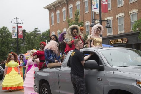 Area drag queens interact with parade attendees at Iowa City Pride on Saturday, June 15, 2019.
