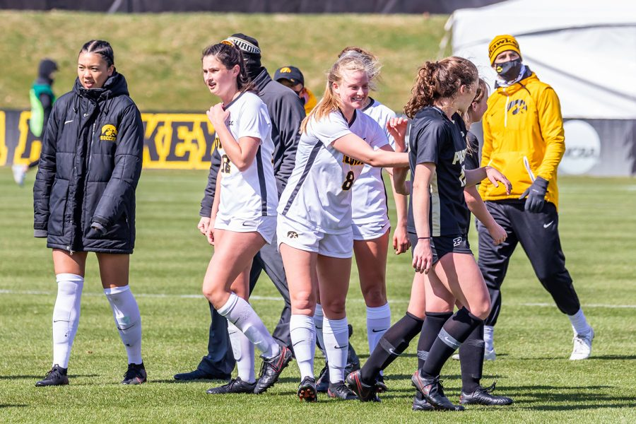 The Iowa Hawkeyes celebrate and congratulate Purdue on a great game at the end of the Iowa Soccer senior day game against Purdue on Mar. 28, 2021 at the Iowa Soccer Complex. Iowa defeated Purdue 1-0.