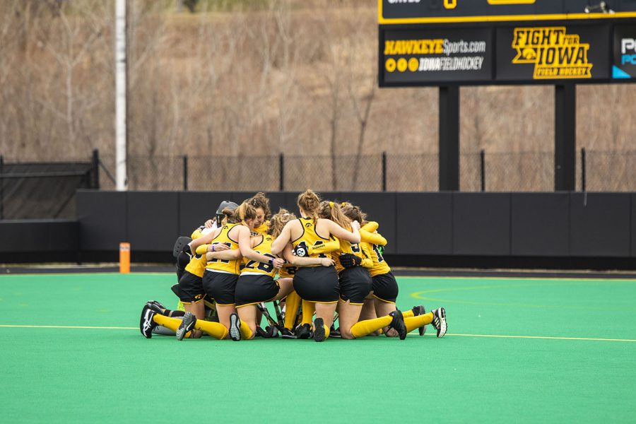 Iowa players huddle before the field hockey game between Iowa and Michigan at Grant Field on Saturday, March 15, 2021. The Hawkeyes defeated the Wolverines, 2-1, in a shootout.