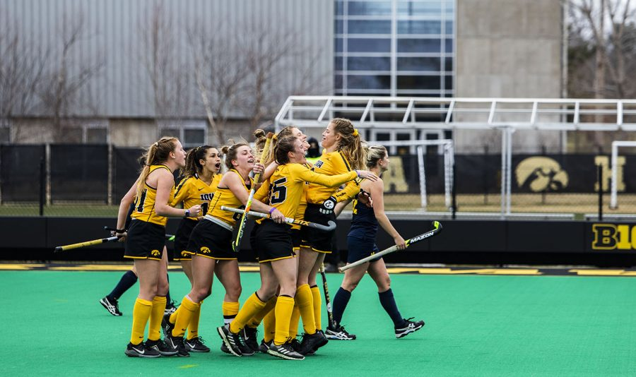Hawkeyes+celebrate+their+first+point+during+a+field+hockey+game+between+Iowa+and+Michigan+at+Grant+Field+on+Saturday%2C+March+15%2C+2021.+The+Hawkeyes+defeated+the+Wolverines%2C+2-1%2C+in+a+shootout.