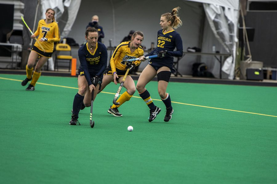 Iowa moves the ball upfield during a field hockey game between Iowa and Michigan at Grant Field on Saturday, March 15, 2021. The Hawkeyes defeated the Wolverines, 2-1, in a shootout.