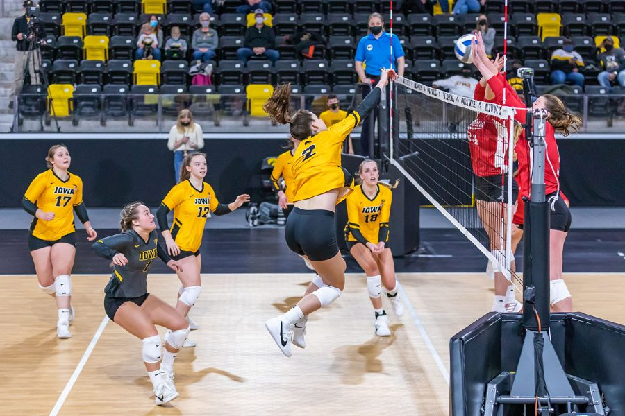 Iowa Outside Hitter Courtney Buzzerio hits the ball over the net during the Iowa Volleyball game against Indiana on Feb. 6, 2021 at Xtream Arena. Indiana defeated Iowa 3-2.