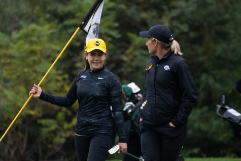 Iowa head coach Megan Menzel talks to Manuela Lizarazu during the Diane Thomason Invitational at Finkbine Golf Course on September 30th, 2018.The Hawkeyes placed 1st overall.
