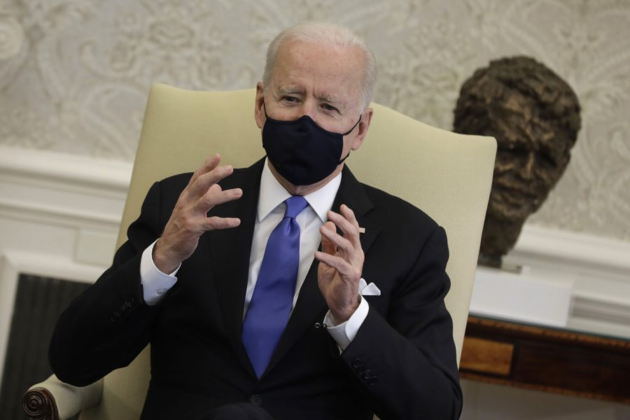 U.S. President Joe Biden holds in the Oval Office at the White House in Washington D.C., on March 3, 2021.