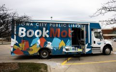 The Iowa City Public Libraries' Bookmobile on Thursday, March 18, 2021. Sitting in the Hy-Vee parking lot, 812 S. 1st ave, one of many locations. Library patrons can place a book on hold and pick it up from the bookmobile.