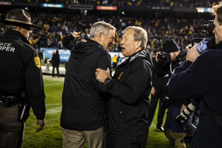 Iowa head coach Kirk Ferentz greets UI President Bruce Harreld after the Holiday Bowl game between Iowa and USC at SDCCU Stadium on Friday, December 27, 2019. The Hawkeyes defeated the Trojans 49-24.