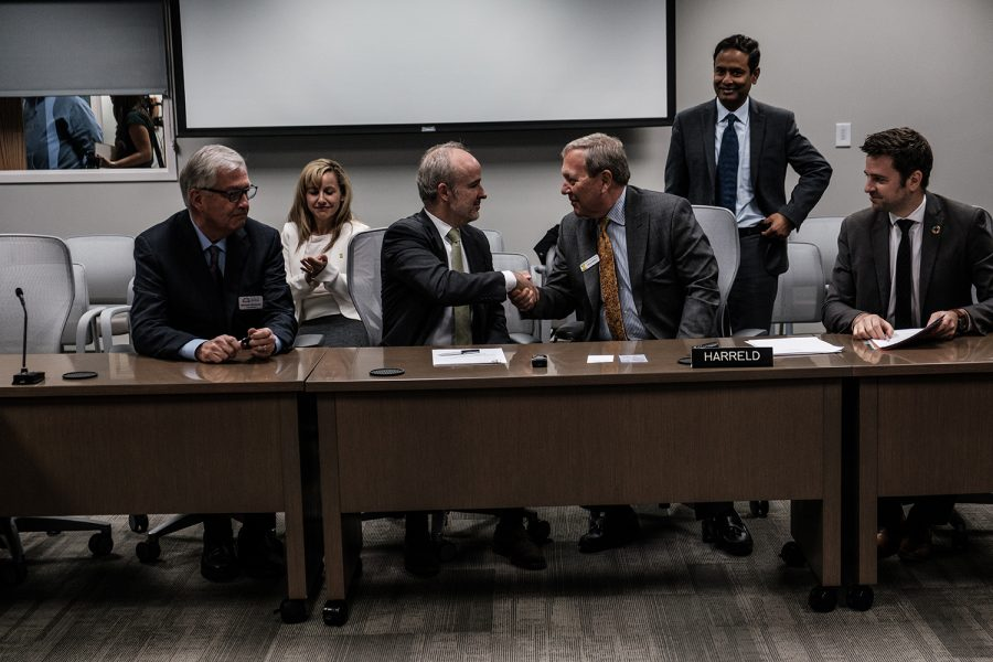 ENGIE Head of Business Development in North America André Canguçu shakes hands with University of Iowa President Bruce Harreld after the Public/Private Partnership is made official following a meeting with the state Board of Regents in Urbandale on Tuesday, December 10, 2019. The Board of Regents voted unanimously to pass the Public/Private Partnership.