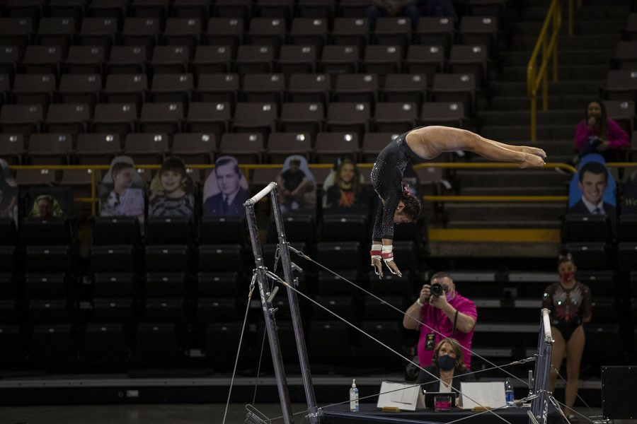 Iowas Clair Kaji performs a bars routine during a gymnastics meet against Ohio State on Saturday, Jan. 23, 2021 at Carver Hawkeye arena. The Hawkeyes defeated the Buckeyes with a score, 196.550-193.800. Kaji earned a score of 9.850.