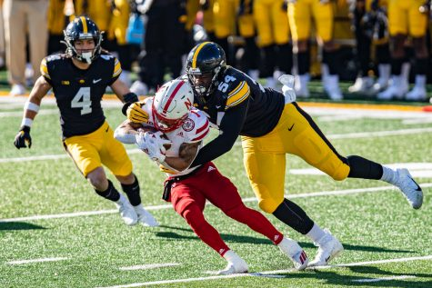 Iowa defensive tackle Daviyon Nixon tackles Nebraska