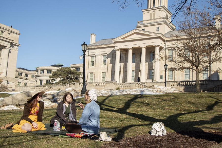 Liv Plowman (left), Makenzie Schmidt (middle), and Sophie Selc (right) are pictured having a picnic on the Pentacrest on Tuesday, March 3, 2021, University of Iowa's instructional day. After canceling spring break, Iowa gave students and faculty two instructional breaks during the semester.