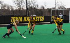 "Michigan Forward Sarah Pyrtek works to move the ball around Iowa defenders Anthe Nijziel (6) and Harper Dunne (23) during a field hockey game between Iowa and Michigan at Grant Field on Saturday, March 15, 2021. ""The Hawkeyes defeated the Wolverines, 2-1, in a shootout."""