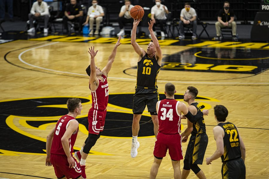 Iowa guard Joe Wieskamp takes a shot during a menÕs basketball game between Iowa and Wisconsin at Carver-Hawkeye Arena on Sunday, March 7, 2021.