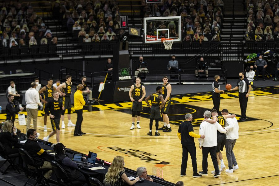 Iowa guard Joe Wieskamp is helped off the court during a menÕs basketball game between Iowa and Wisconsin at Carver-Hawkeye Arena on Sunday, March 7, 2021.