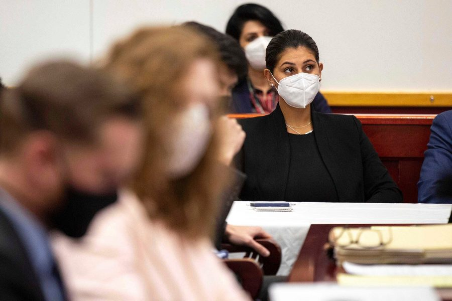 Des Moines Register reporter Andrea Sahouri listens to opening statements in her trial on Monday at the Drake University Legal Clinic in Iowa.