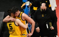 Iowa Hawkeyes center Luka Garza (55) hugs guard CJ Fredrick (5) after their 95-80 loss against the Oregon Ducks during the second round of the 2021 NCAA Tournament on Monday, March 22, 2021, at Bankers Life Fieldhouse in Indianapolis, Ind. Mandatory Credit: Sam Owens/IndyStar via USA TODAY Sports