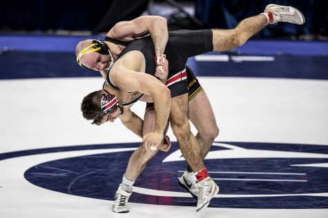 Iowa's Alex Marinelli returns Ohio State's Ethan Smith during the finals of the Big Ten Wrestling Tournament at the Bryce Jordan Center in State College, PA on Sunday, March 8, 2021. The Hawkeyes won the Big Ten Title with a team score of 159.5. This is the 37 Big Ten Title in school history. (Ryan Adams/The Daily Iowan)