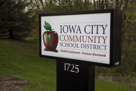 A sign for the Iowa City Community School District is seen outside the district