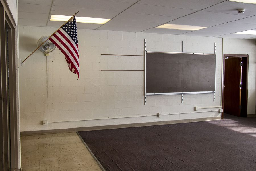 The American flag is seen hanging in an abandoned room at Theodore Roosevelt Education Center seen on Monday, Feb. 22, 2021.