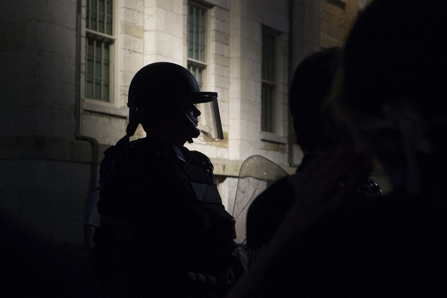 A uniformed officer wears a face shield and holds a riot shield on Wednesday June 3, 2020 outside the Old Capitol building. Protesters chanted,