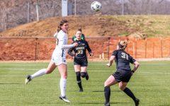 Iowa Forward Samantha Tawharu heads the ball during the Iowa Soccer senior day game against Purdue on Mar. 28, 2021 at the Iowa Soccer Complex. Iowa defeated Purdue 1-0.