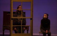 """Raven, played by Emma Kohlenberg, watches as Poe, played by Ellie Turk, looks out the window during the """"Sirens of the Field"""" dress rehearsal in Thayer Theatre in the Theatre Building on Wednesday, March 17, 2021. """"Sirens of the Field"""" is a student written and directed play; written/co-directed by Brett Stone, and co-directed by Jivani Rodriguez. There will be a virtual performance of """"Sirens of the Field"""" on Saturday, March 27, at 8:00pm."""