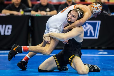 Iowa's 125-pound Spencer Lee wrestles Oklahoma State's Nicholas Piccininni during the fourth session of the 2019 NCAA D1 Wrestling Championships at PPG Paints Arena in Pittsburgh, PA on Friday, March 22, 2019. Lee won by decision, 11-4, and earned a spot in the finals of his weight class.
