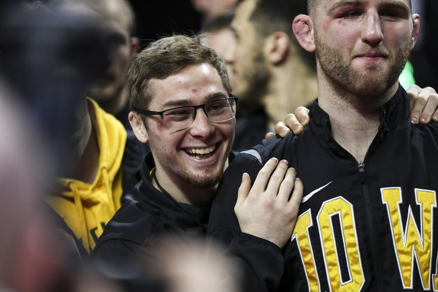 Iowa's 125-pound Spencer Lee smiles while posing for photos with his team during the final session of the Big Ten Wrestling Tournament in Piscataway, NJ, on Sunday, March 8, 2020. Lee won by major decision 16-2, securing the 125-pound championship, and Iowa won the team title with 157.5 points. (Nichole Harris/The Daily Iowan)