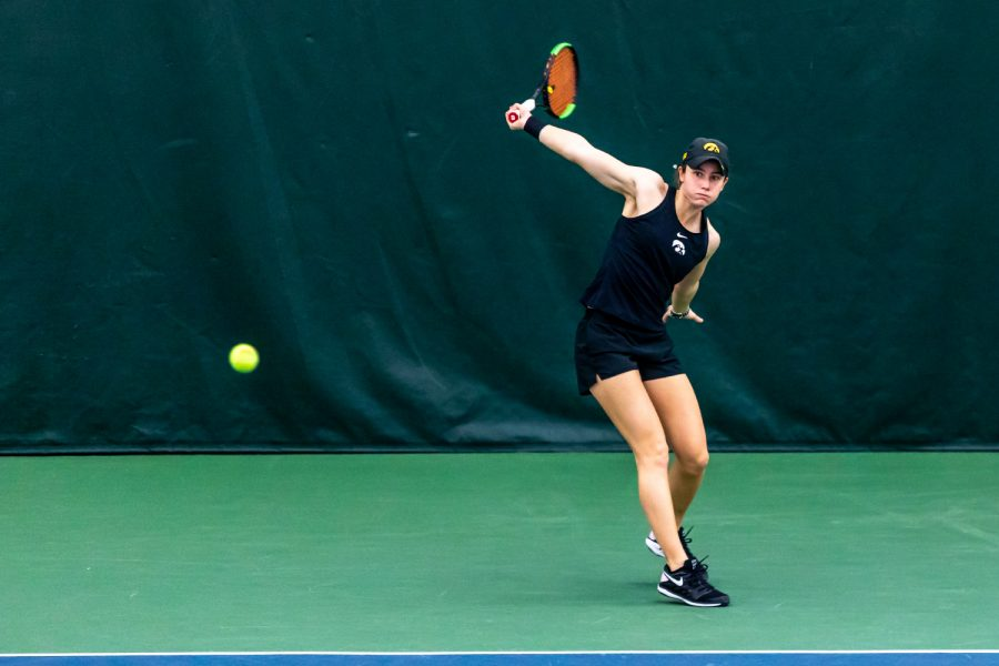 Iowa's Elise van Heuvelen Treadwell sends the ball over the net during the Iowa Women's Tennis match against Purdue on Feb. 28, 2021 at the Hawkeye Tennis and Recreation Complex. Iowa defeated Purdue 6-1.