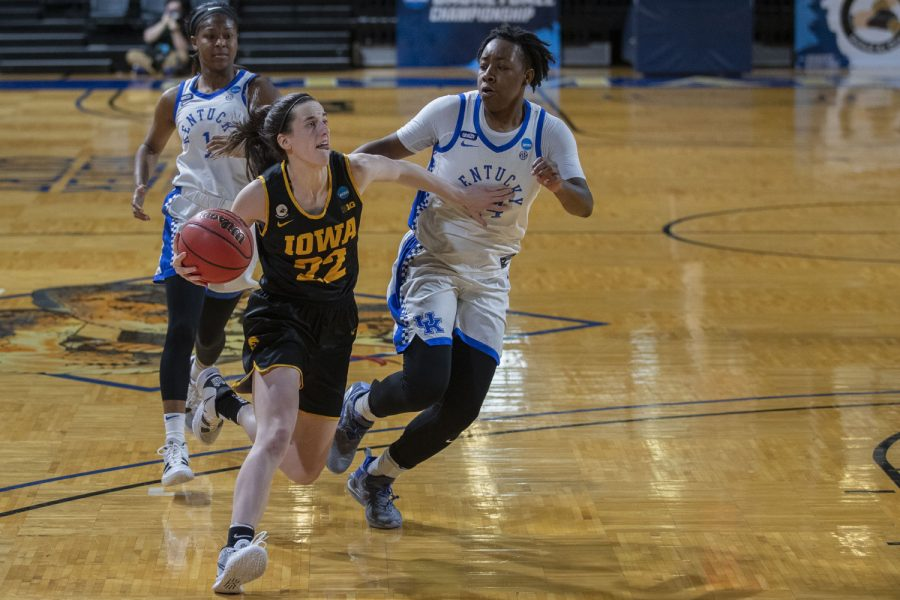 Iowa guard Caitlin Clark dribbles toward the basket during the second round of the NCAA women