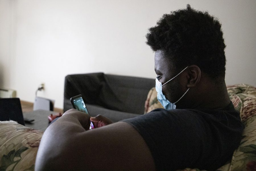 University of Iowa sophomore Joslin Some video chats with his younger sister on Saturday, March 14, 2021 at his apartment in Iowa City. Some is an international student from Ouagadougou, the capital of Burkina Faso in West Africa. His sister calls often, he says, and they often speak in a combination of English and French over the phone. (Jenna Galligan/The Daily Iowan)