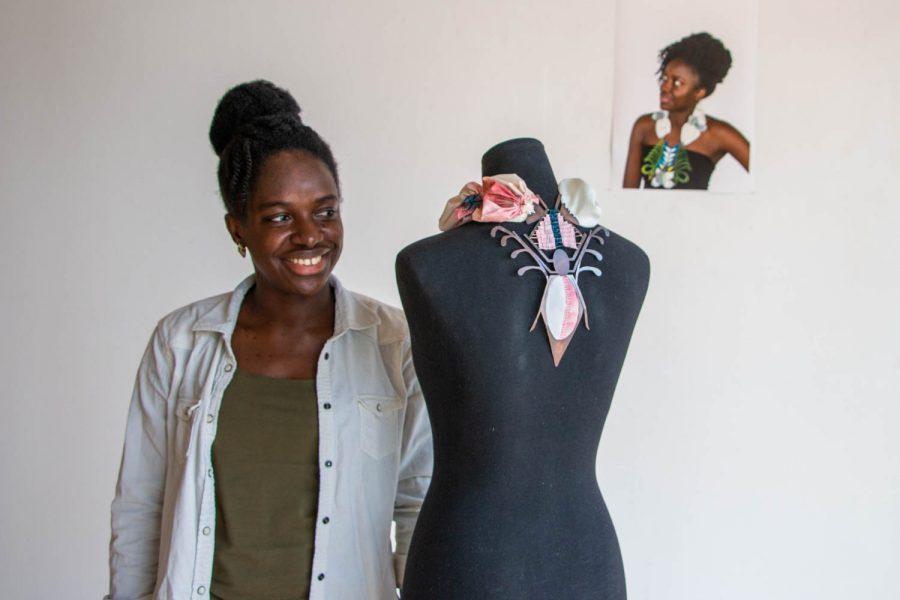 Dufie Sakyiama poses for a portrait with her pieces at an art and jewelery gallery,
