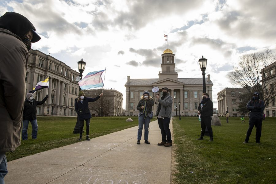 Community members speak during the Trans Day of Visibility rally at the Pentacrest on Wednesday, March 31, 2021. The event was put on by the LGBTQ Iowa Archives and Library, and featured chalking and speeches by members of the community.