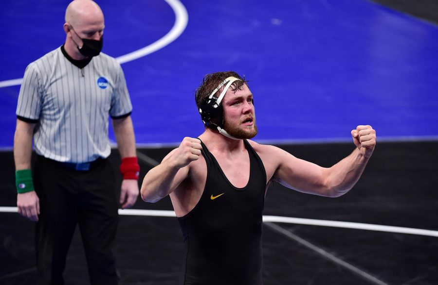 Mar 18, 2021; St. Louis, Missouri, USA;  Iowa Hawkeyes wrestler Jacob Warner celebrates after defeating NC State Wolfpack wrestler Nick Reenan during the NCAA Division I Wrestling Championships at Enterprise Center. Mandatory Credit: Jeff Curry-USA TODAY Sports
